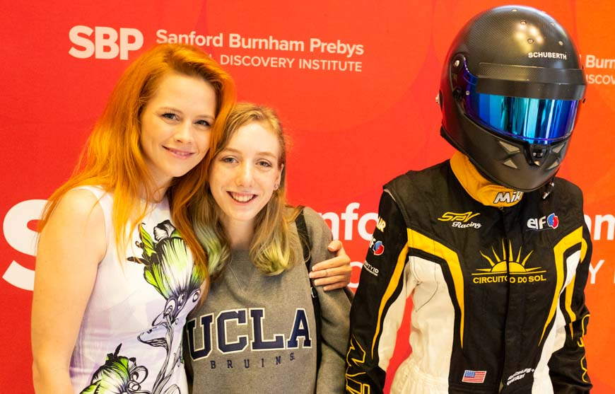 17-year-old Madison Koslowski (right), who was diagnosed last year with juvenile idiopathic arthritis, poses with race-car driver Angela.