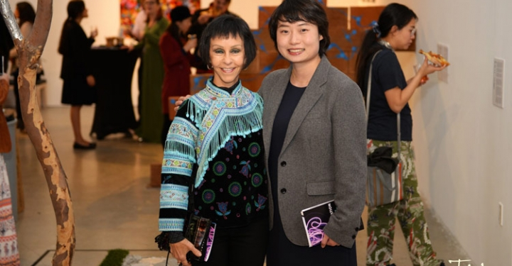 Neuroscientist LuLin Jiang and artist Becky Guttin pose next to Guttin's installation, an allegory of Alzheimer's in progress. Photo credit: Tim Hardy Photography.