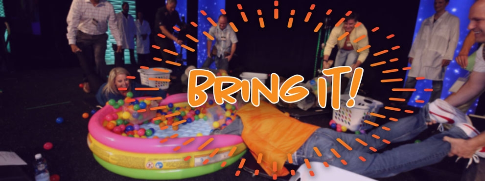 Game players on stage at Bring It! 2017 with Bring It logo overalyed