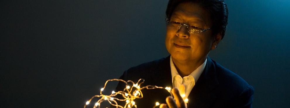 Jerold Chun, M.D., Ph.D. holding string lights