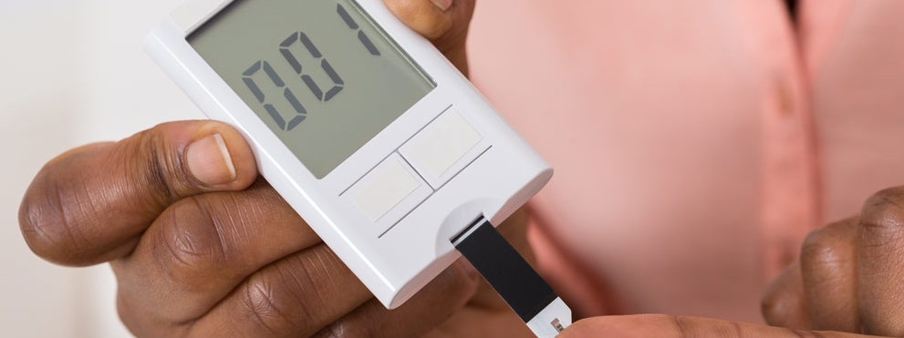Close up of hands doing diabetes test