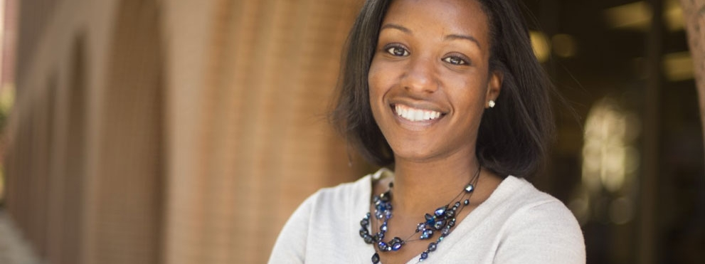 Stacey D. Finley, Ph.D. profile photo, headshot outside brick building