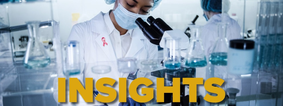 insights breast cancer graphic, black woman scientist at work in lab