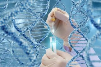 DNA research with a sample. Hand with a test tube on a DNA background shutterstock_653790793.jpg