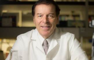 Headshot of Garth Powis, D. Phil., professor and director of the Sanford Burnham Prebys Medical Discovery Institute (SBP) NCI-designated Cancer Center.